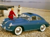 Car girl and Porsche 356 on beach