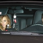Lindsay Lohan and Sam at night in Porsche 911