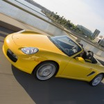 2008 yellow Porsche Boxster wallpaper Side angle view