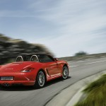 2011 Guards Red Porsche Boxster S wallpaper Rear angle view