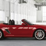 2011 Guards Red Porsche Boxster S wallpaper Side view