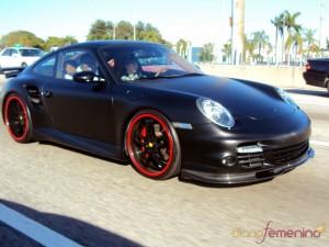 Justin Bieber driving in black Porsche 911 Turbo