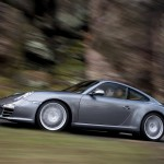 2009 Grey Porsche 911 Carrera 4 Wallpaper Side view In motion