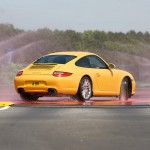 2009 Yellow Porsche 911 Carrera Wallpaper Rear angle side view