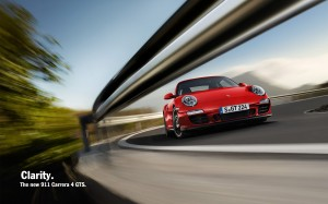 2011 red Porsche 911 Carrera 4 GTS Cabriolet Front angle view