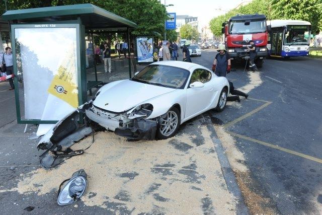 Girl Crashes Porsche Into The Bus Stop